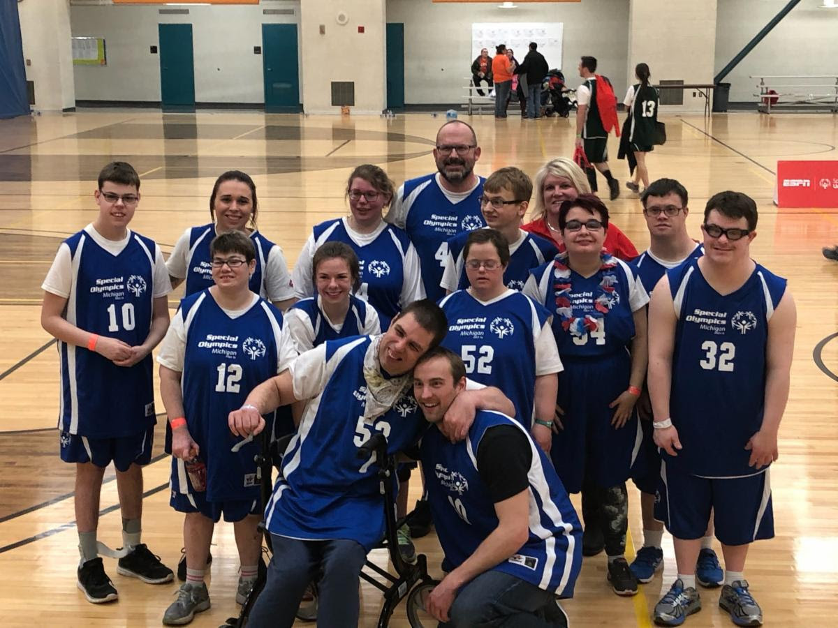 Special Olympics Basketball Karla Piper Coach with Team